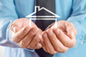 bigstock-House-In-Hands-Of-Businessman-45250603